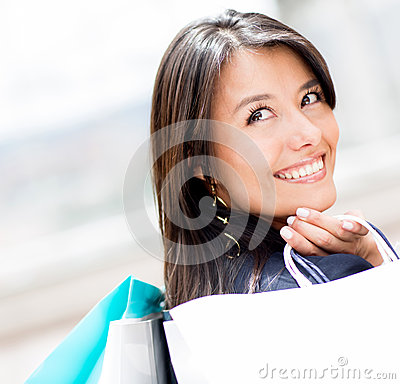 Pensive shopping woman