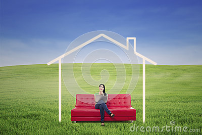 Pensive woman in dream house outdoor