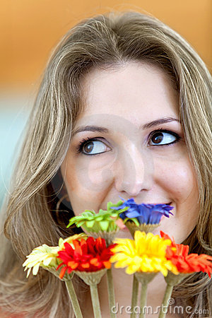 Pensive woman with flowers