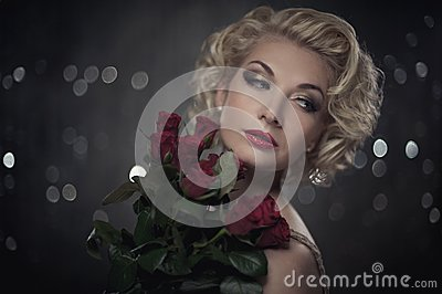 Pensive woman with a flowers