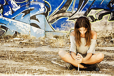 Pensive woman with knife