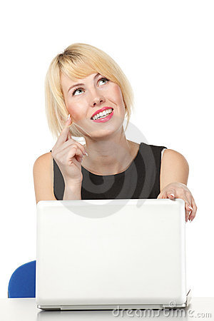 Pensive woman sitting at the table with laptop