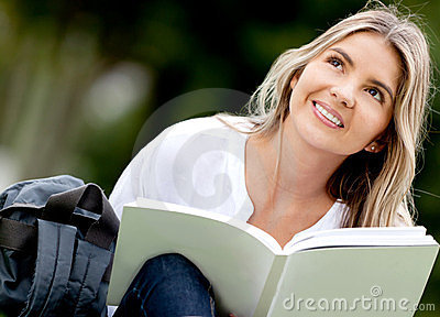 Pensive woman studying outdoors