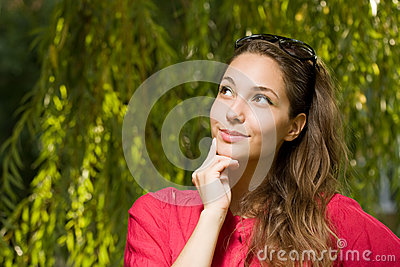 Pensive young brunette woman.