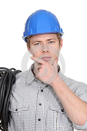Pensive young electrician