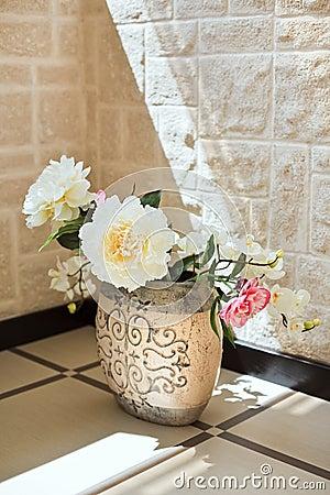 Peony flowers in pottery vase