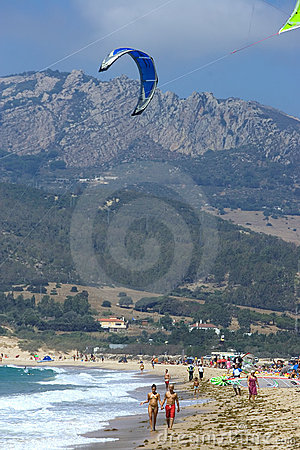People on active kitesurfing beach in Spain