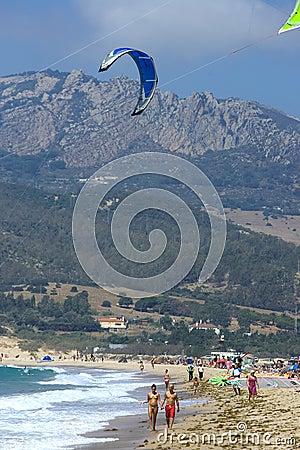 People on active kitesurfing beach in Spain Editorial Photo