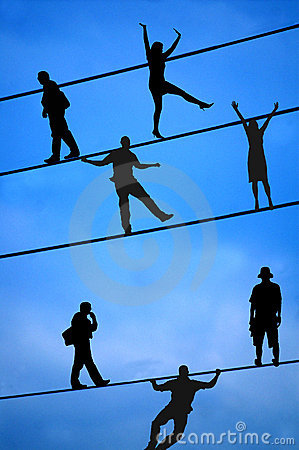 People Balancing on Tight Wire