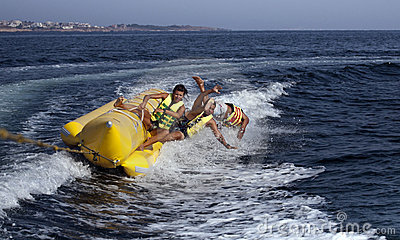 PEOPLE ON A BANANA BOAT