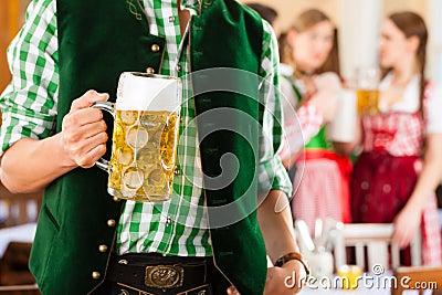 People in Bavarian Tracht in restaurant