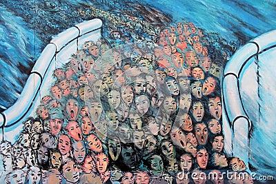 People through Berlin wall Editorial Stock Photo