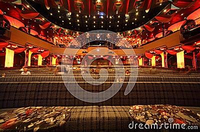 People in big illuminated hall of Costa Deliziosa Editorial Photo
