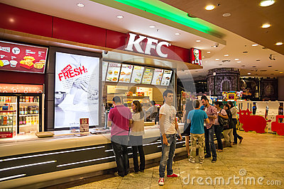 People Buying Fried Chicken Editorial Photo