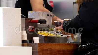 People buying hot dog at food court area. Inside Burnaby shopping mall stock video footage