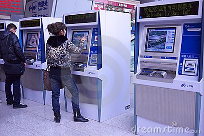 People buying ticket automatic machine Editorial Stock Image