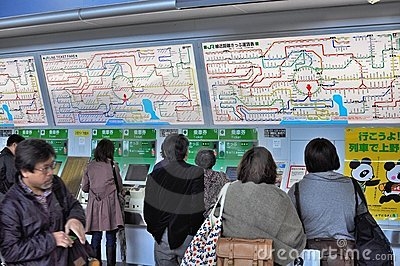 People buying tickets at Shinjuku JR station Editorial Stock Photo