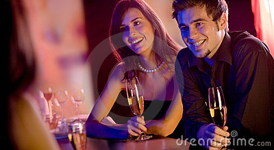 People with champagne glasses in restaurant, meeting