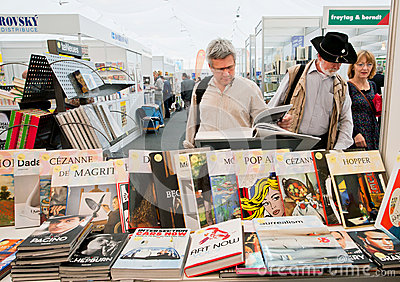 People choose art and photo books at the book market Editorial Photography