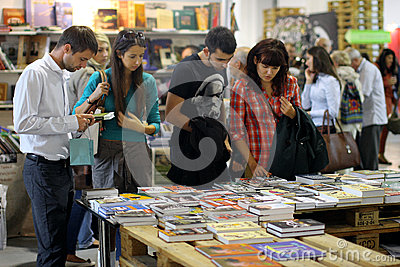 People choose the books at festival Editorial Photo