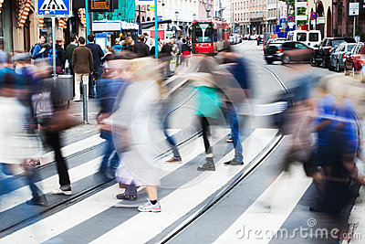 People in the city crossing the street