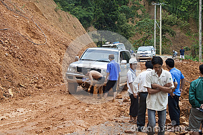 People clear a road because of landslide Editorial Photography