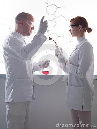 People conducting lab experiment