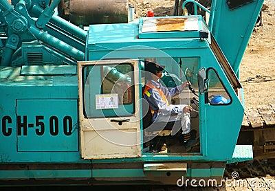 People control excavator Editorial Stock Photo