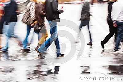 People crossing the wet street