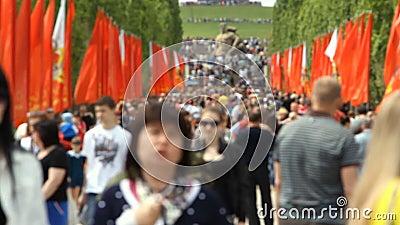 People crowd rises on Mamayev Kurgan. Volgograd, Russian Federation - May 09, 2015: People crowd rises on Mamayev Kurgan. Out of focus stock video footage