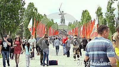 People crowd rises on Mamayev Kurgan. Volgograd, Russian Federation - May 09, 2015: People crowd rises on Mamayev Kurgan. Out of focus stock video