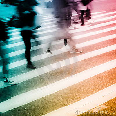 People crowd on zebra crossing street