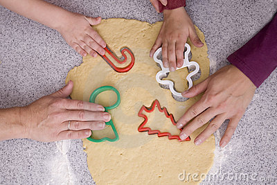 People cutting out cookies