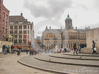 People on the Dam Square in front of Amsterdam Royal Palace . N