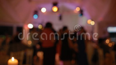 People dance on the party. Party out of focus, Candle on the first plan stock video footage