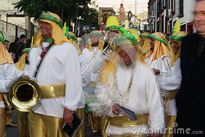People disguised 4.- Brass band Editorial Stock Photo