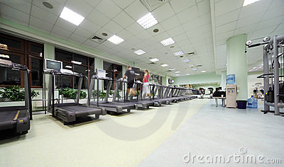 People do on training apparatus in sport club