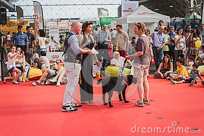 People and dogs at Quattrozampeinfiera in Milan, Italy