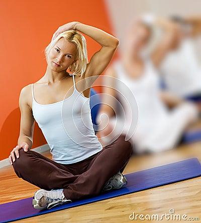 People doing yoga exercise