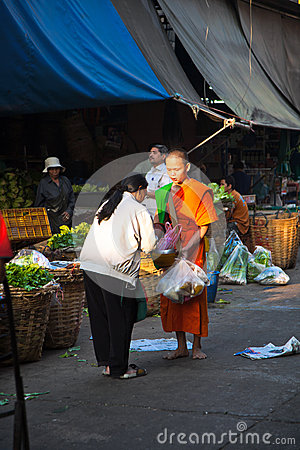People donate food to the monk Editorial Image