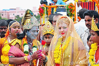People dressed as Lord Krishna and Goddess Radha in India