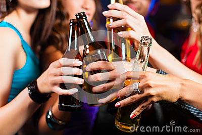 People drinking beer in bar or club