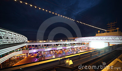 People enjoy night party on deck of cruise ship