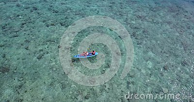 V09399 People enjoying boats and watersports with view from aerial flying drone in clear aqua blue sea water and blue Stock Photo