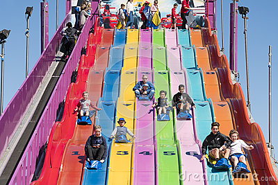 People enjoying a giant slide Editorial Stock Photo