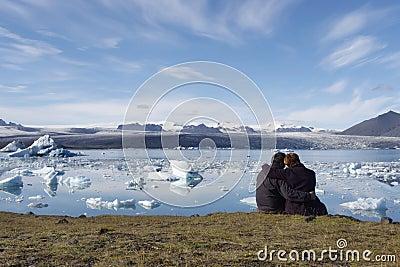 People enjoying the icebergs in Iceland