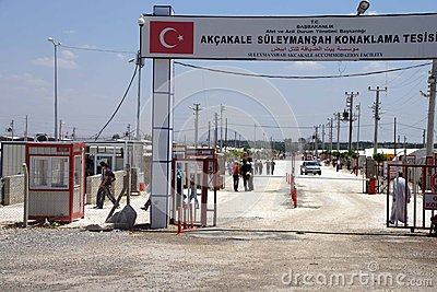 People enter the Akcakale Syrian  refugee camp Editorial Stock Image