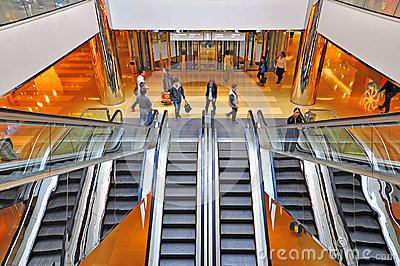 People on escalators in a shopping mall Editorial Photo