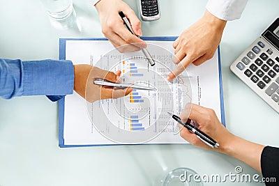 People examining economic booming statistic