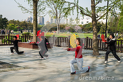 People exercising tai chi with fan gucheng park shanghai china Editorial Photo